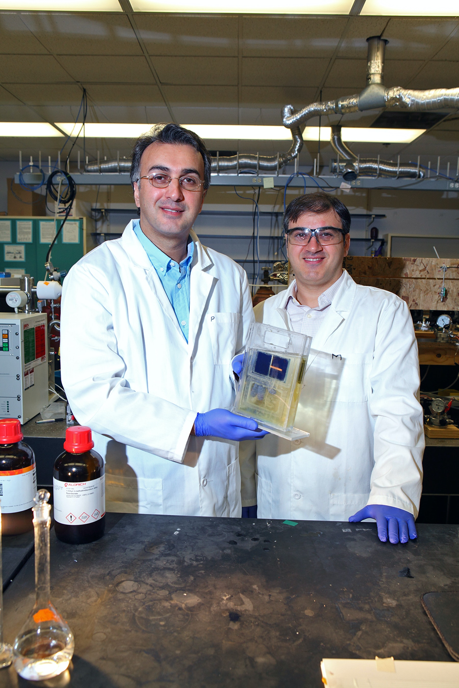 Dr. Amin Salehi-Khojin (left) and postdoctoral researcher Mohammad Asadi with their solar cell.