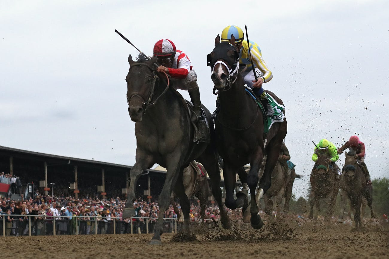 Cloud Computing #2 ridden by Javier Castellano (L) beats Classic Empire #5 ridden by Julien Leparoux to win the 142nd running of the Preakness Stakes at Pimlico Race Course on May 20, 2017 in Baltimore, Maryland.