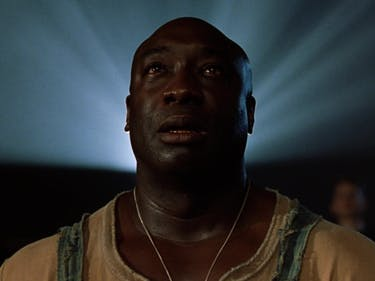 Michael Clarke Duncan as John Coffey