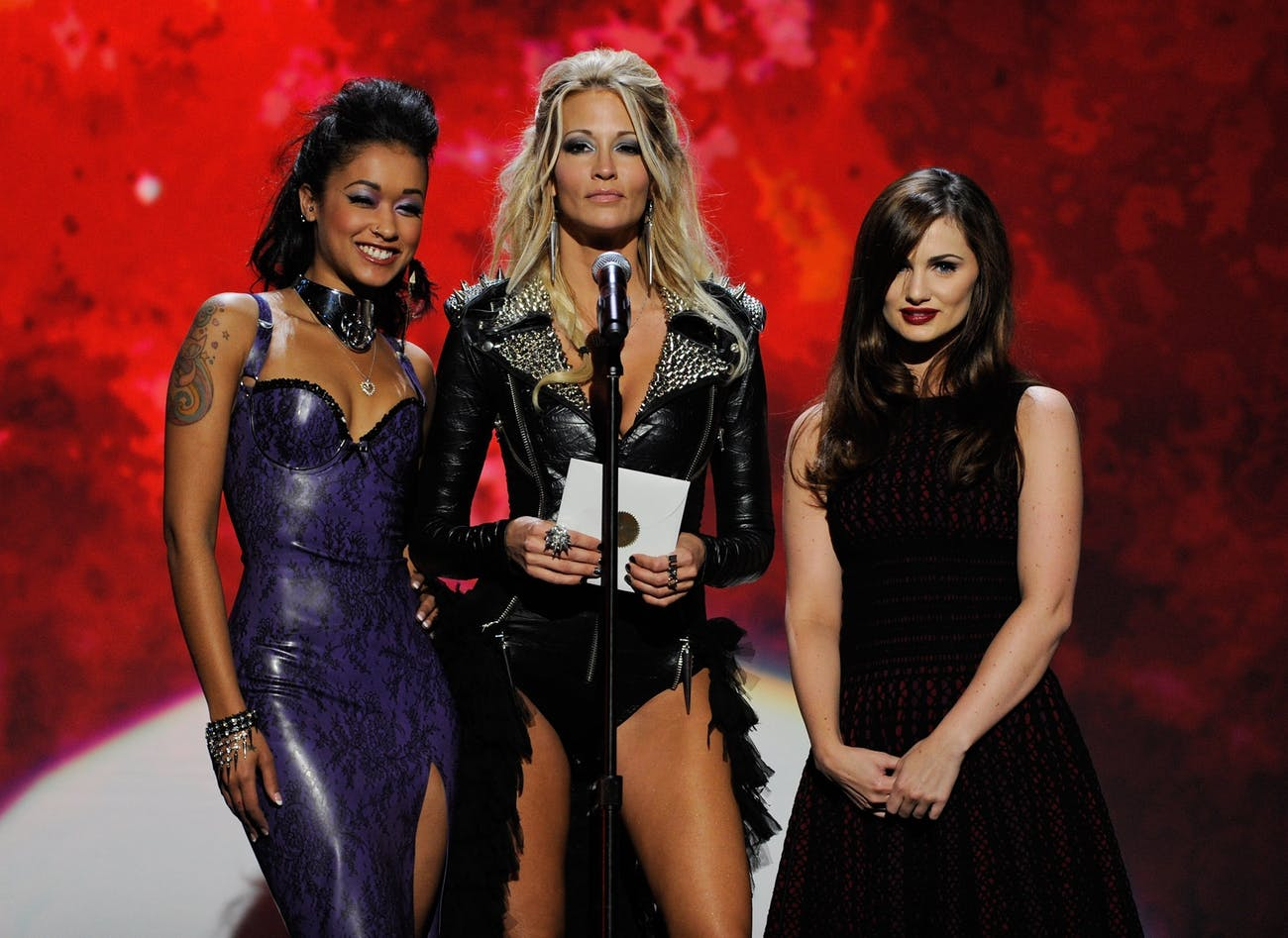 LAS VEGAS, NV - JANUARY 21: (L-R) Adult film actresses Skin Diamond, jessica drake and Lily Carter present an award during the 29th annual Adult Video News Awards Show at The Joint inside the Hard Rock Hotel & Casino January 21, 2012 in Las Vegas, Nevada. (Photo by Ethan Miller/Getty Images)