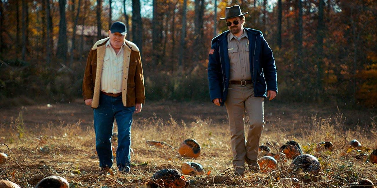 David Harbour as Sheriff Hopper in a field in 'Stranger Things'