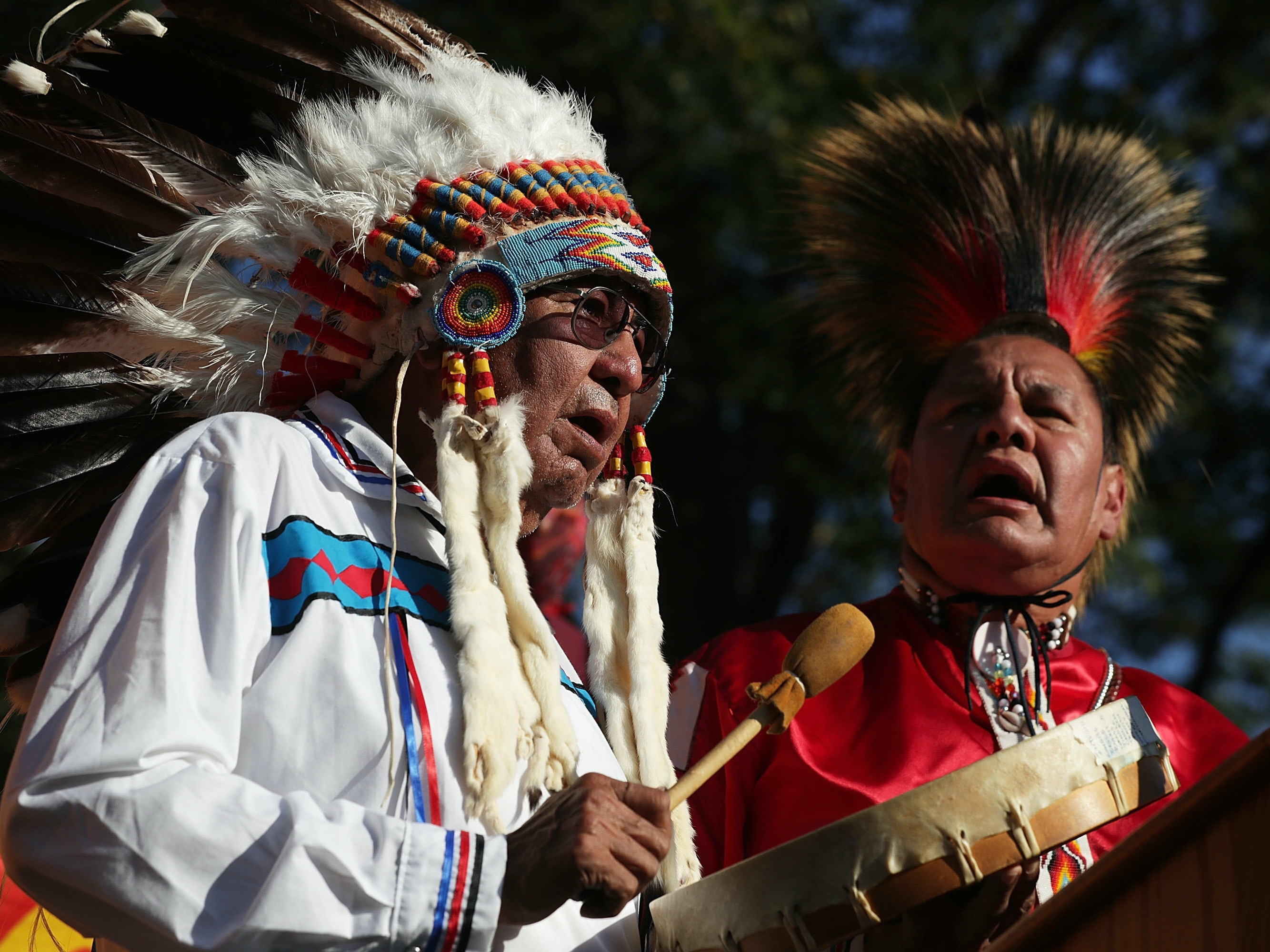 Dennis Zotigh (R) and his father Ralph Zotigh (L) of the Kiowa, Dakota, and Pueblo Tribes sing during a rally against the Dakota Access Pipeline this September in Washington, DC.