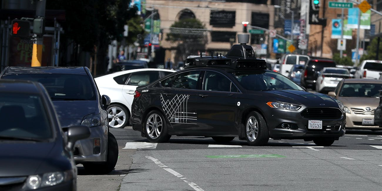SAN FRANCISCO, CA - MARCH 28: An Uber self-driving car drives down 5th Street on March 28, 2017 in San Francisco, California. Cars in Uber's self-driving cars are back on the roads after the program was temporarily halted following a crash in Tempe, Arizona on Friday. (Photo by Justin Sullivan/Getty Images)
