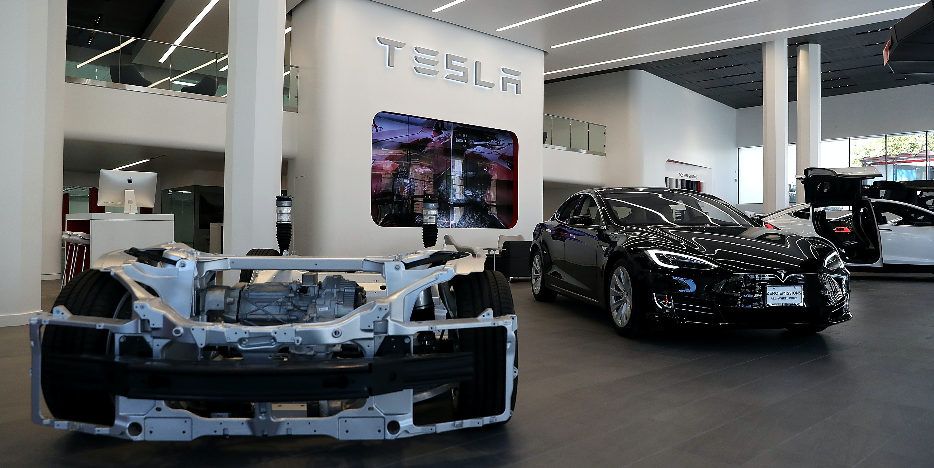 A Tesla Model S is displayed inside of the new Tesla flagship facility in San Francisco, California.