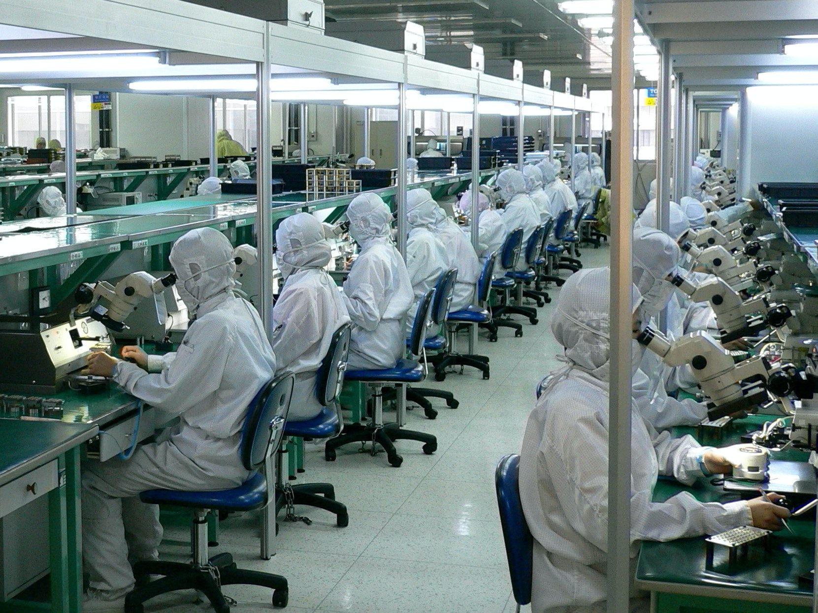 Thousands of workers in a Shenzhen factory assemble and test fiber optic systems.