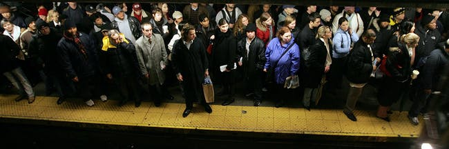 NEW YORK - DECEMBER 16: Commuters wait in Union Square station during the morning rush-hour December 16, 2005 in New York City. Transit workers continue to negotiate a contract with the Metropolitan Transit Authority (MTA) while calling for a selective private bus line strike. (Photo by Mario Tama/Getty Images)