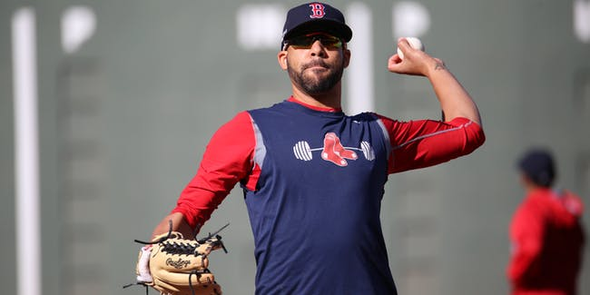 Red Sox pitcher David Price warms up before ALDS Game 3 at Fenway Park.