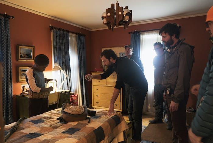 Filmmakers Matt and Ross Duffer directing actorCaleb McLaughlin on the set of 'Stranger Things.'