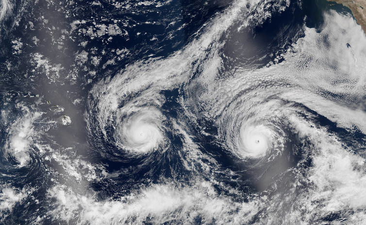 In an image from the Suomi NPP satellite, Hurricanes Madeline and Lester, both hovering between Categories 3 and 4, bear down on Hawaii on Aug. 29, 2016.