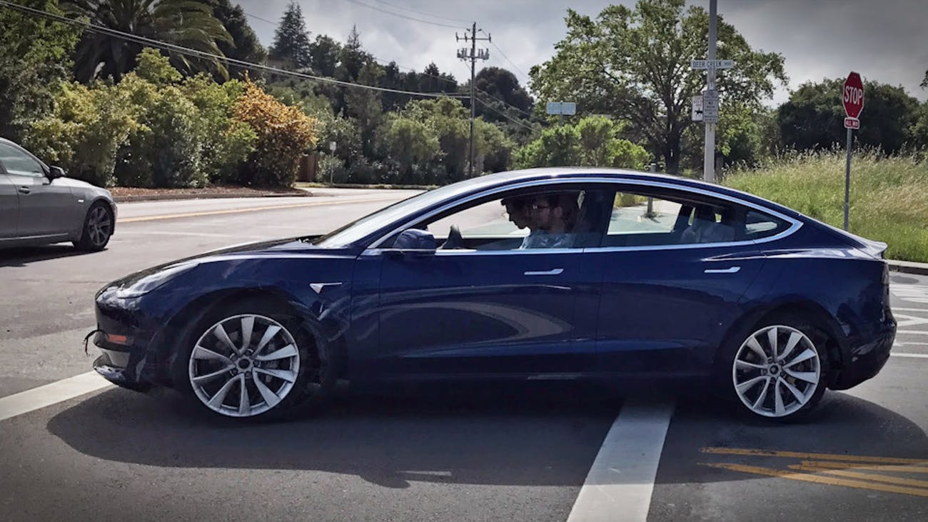 The blue Model 3 out on the road.