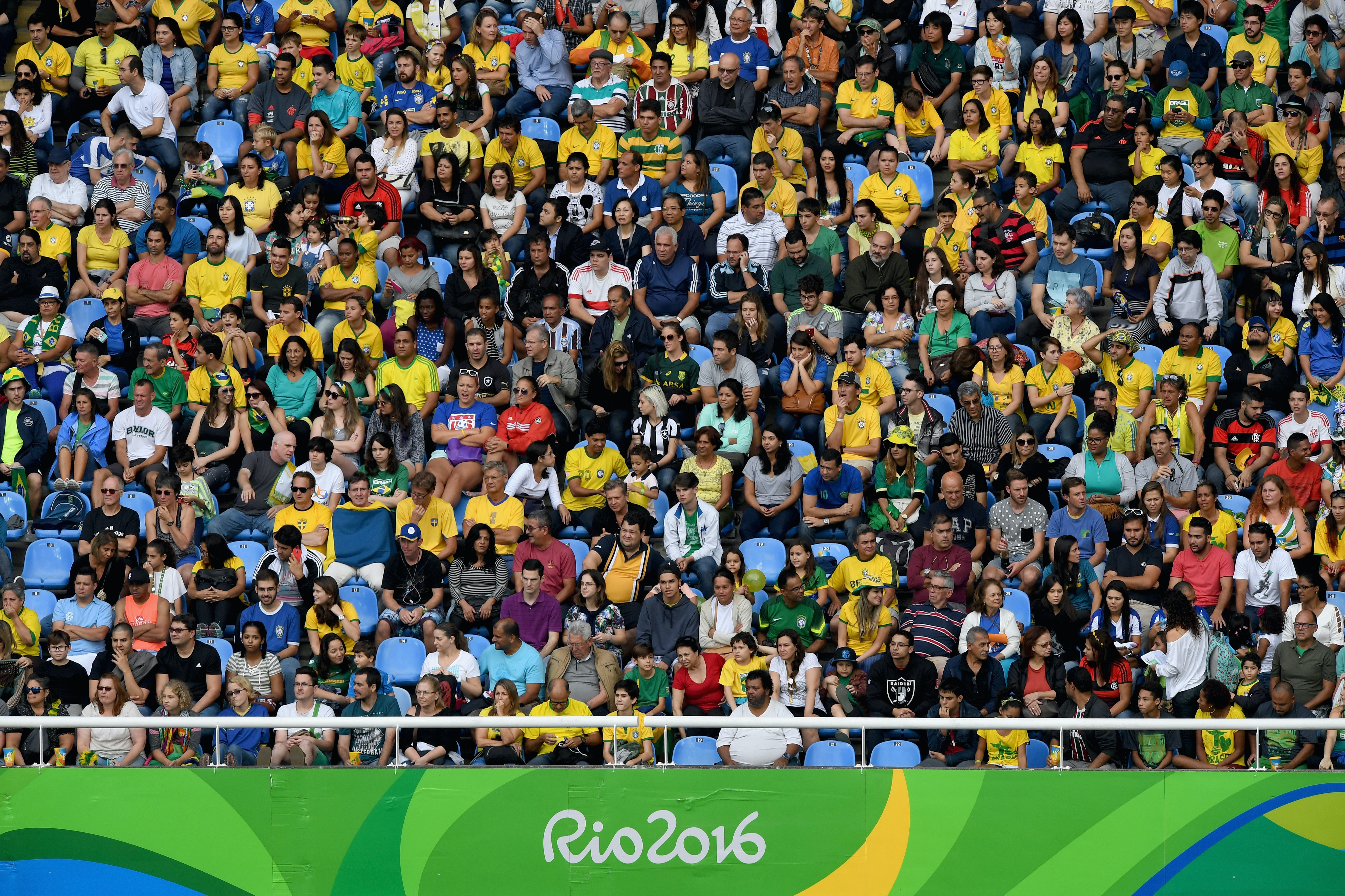 Fans watch the action during the Women's Group E first round match between Brazil and China PR during the Rio 2016 Olympic Games at the Olympic Stadium on August 3, 2016 in Rio de Janeiro, Brazil.