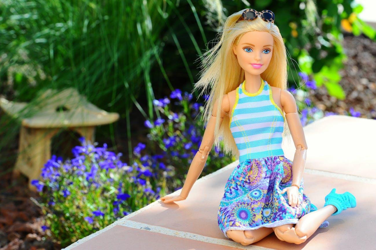Barbie sitting in garden.