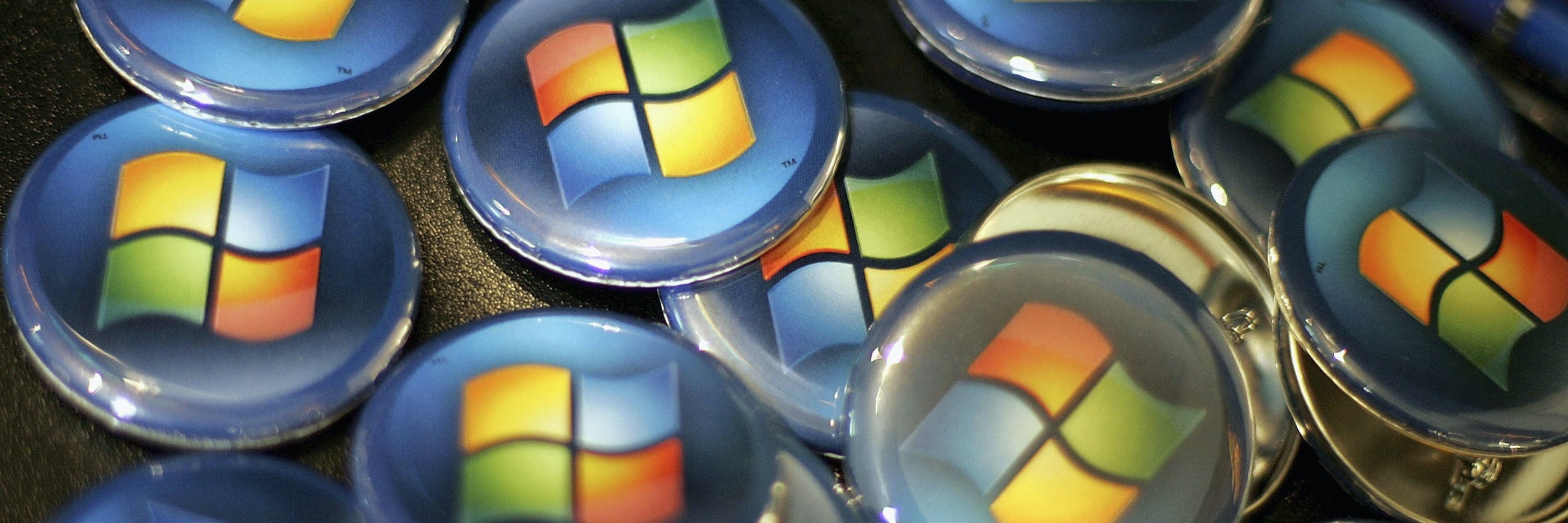 SAN FRANCISCO - JANUARY 29:  Buttons with the Microsoft logo are seen at a Comp USA store January 29, 2007 in San Francisco, California. More than five years in the making, Micorsoft launched Vista, is the latest edition of the Windows operating system and an updated version of Office.  (Photo by Justin Sullivan/Getty Images)