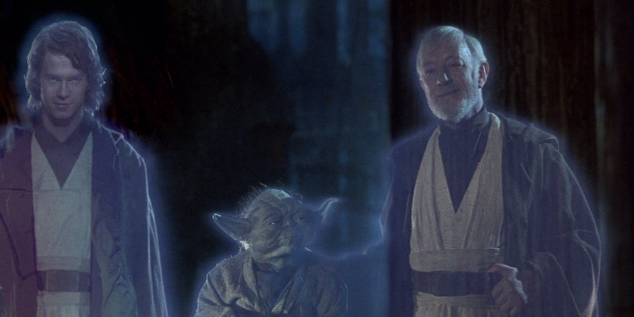 Anakin Skywalker, Yoda, and Obi-Wan Kenobi in Force ghost form at the end of 'Return of the Jedi'.