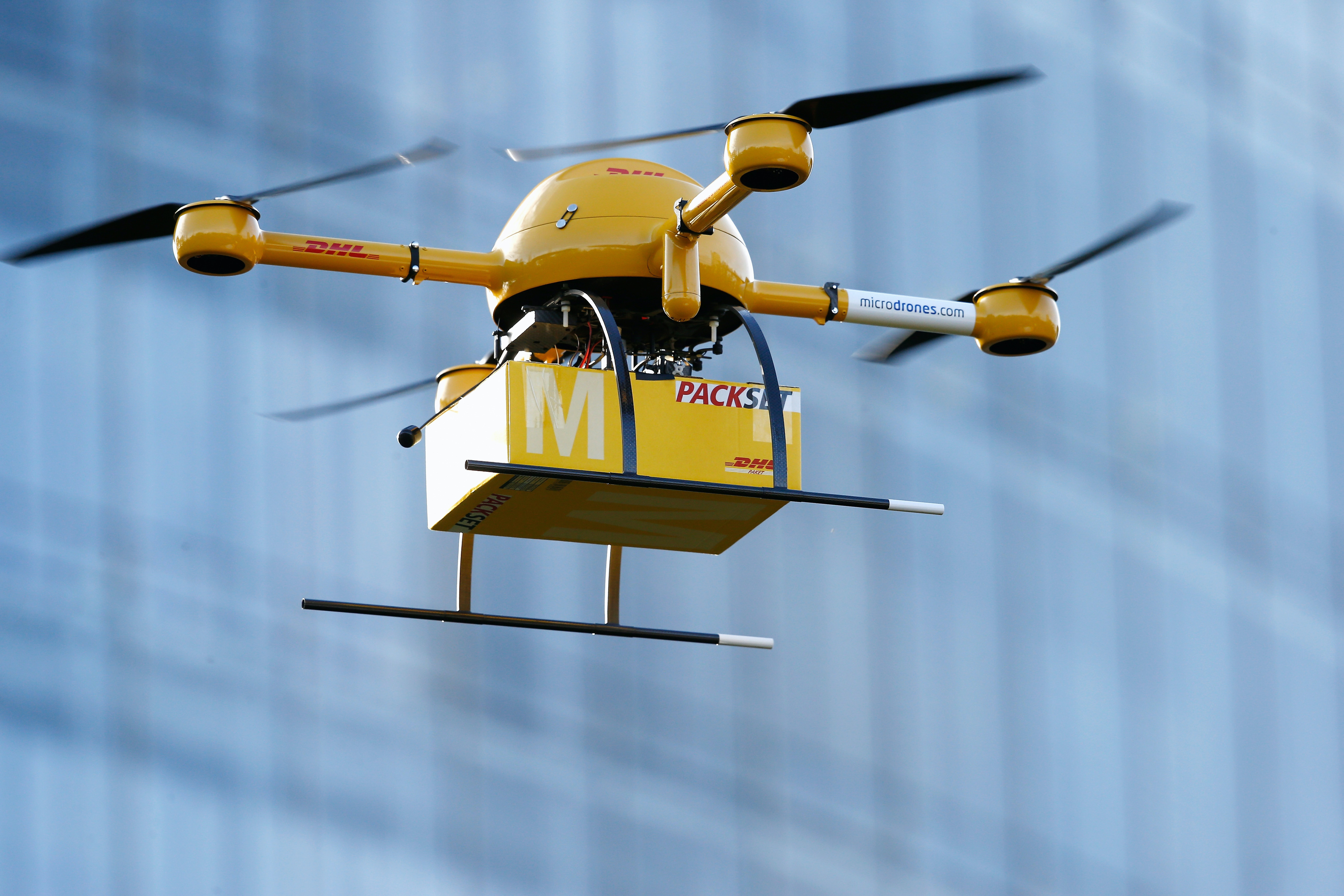 A quadcopter drone arrives with a small delivery at Deutsche Post headquarters on December 9, 2013 in Bonn, Germany.