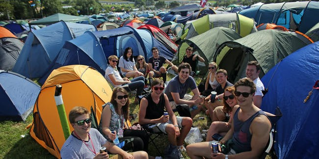 A group of friends at the Glastonbury Festival.