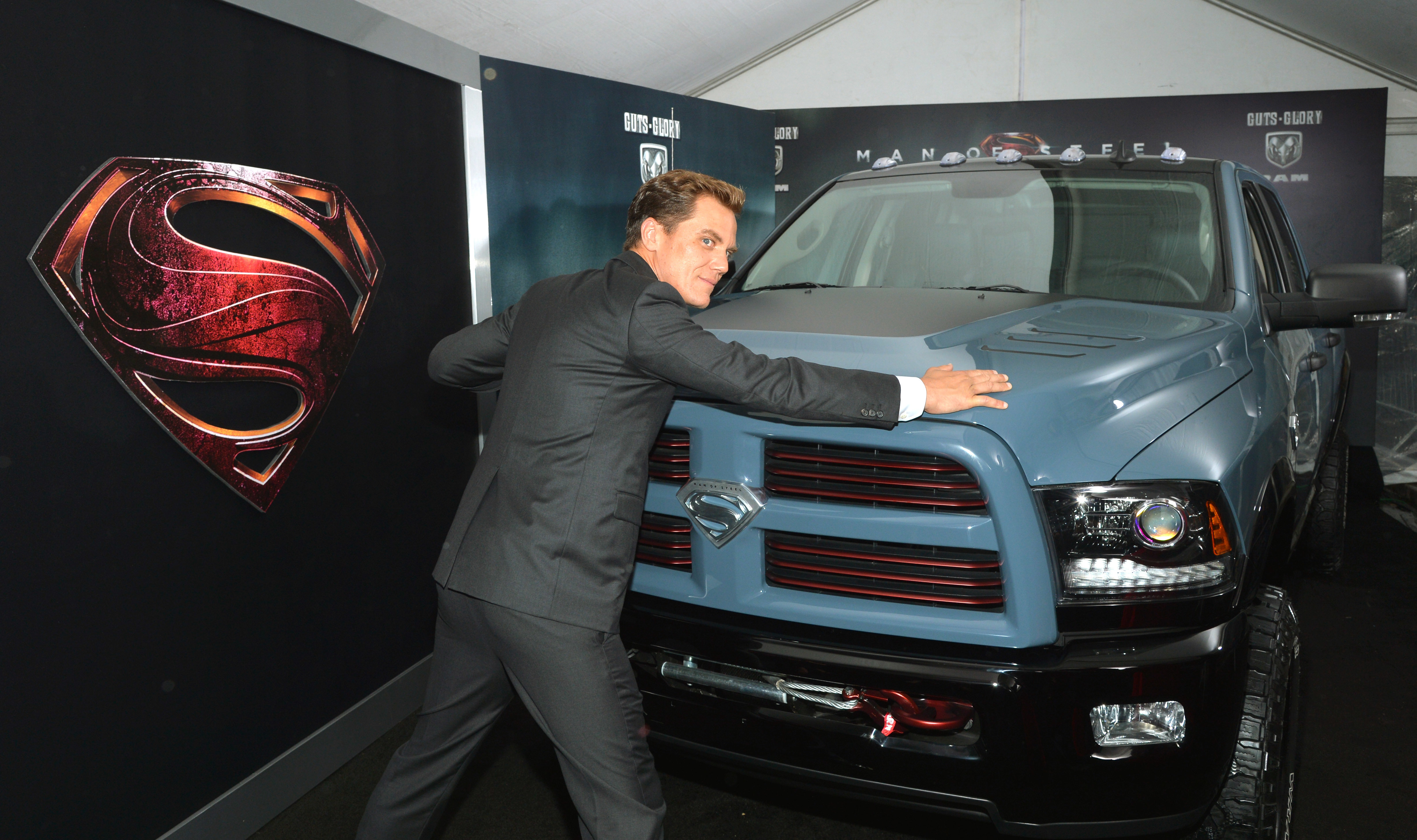 Michael Shannon pretends to stop a car at the 'Man of Steel' premiere.