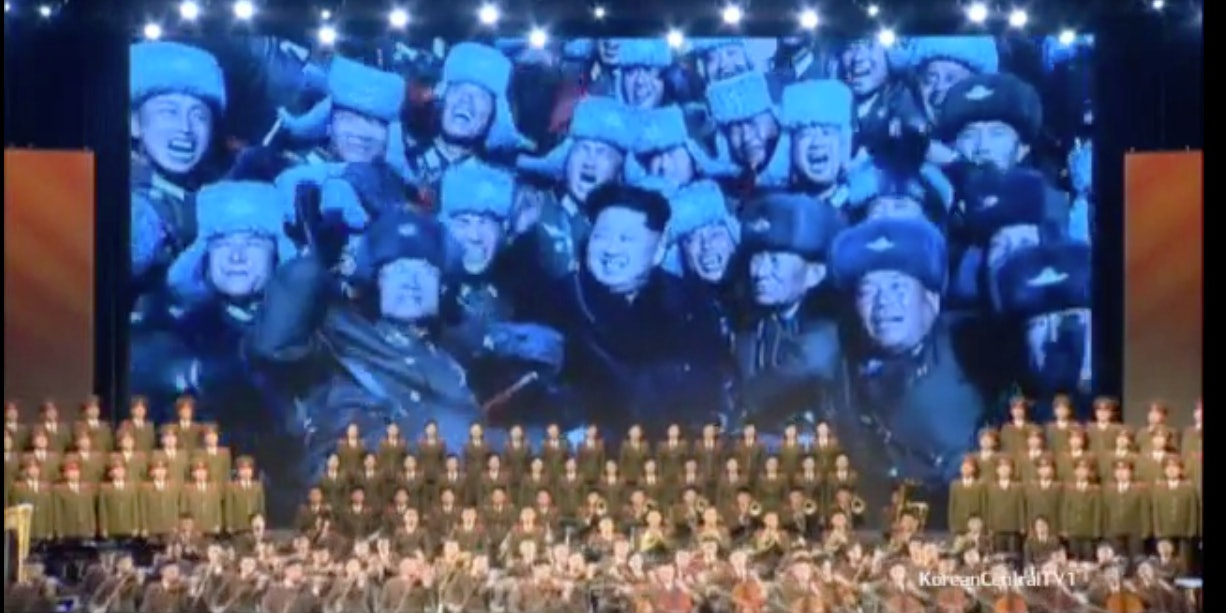 A symphony plays the new Anthem for Kim Jong-un.