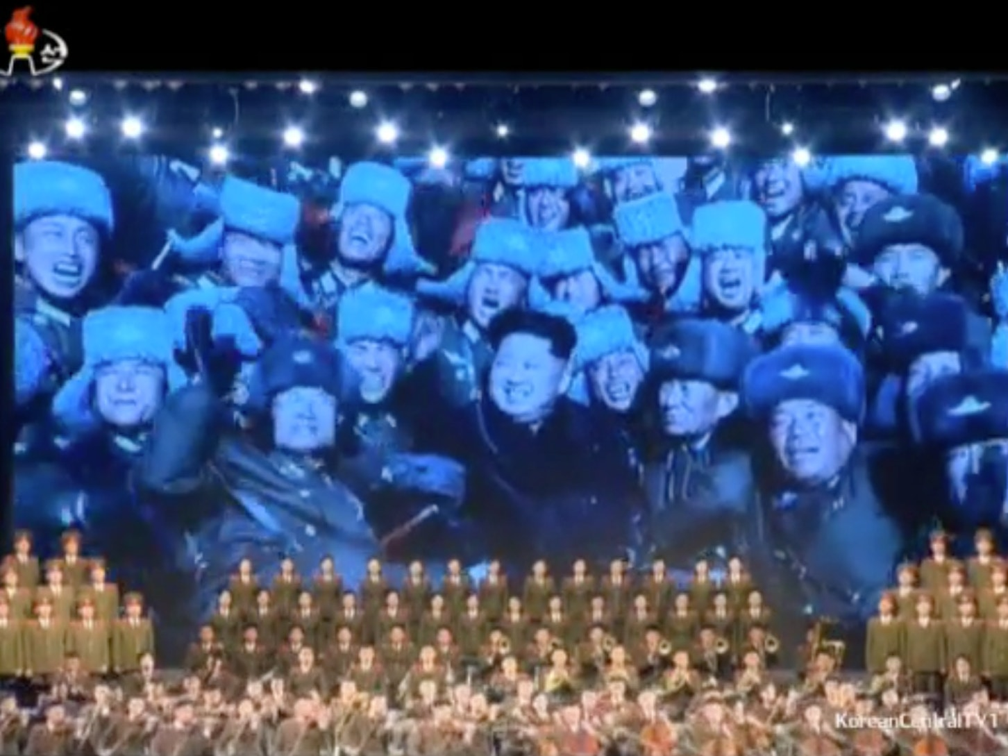 A symphony plays the new Anthem for Kim Jong-un.