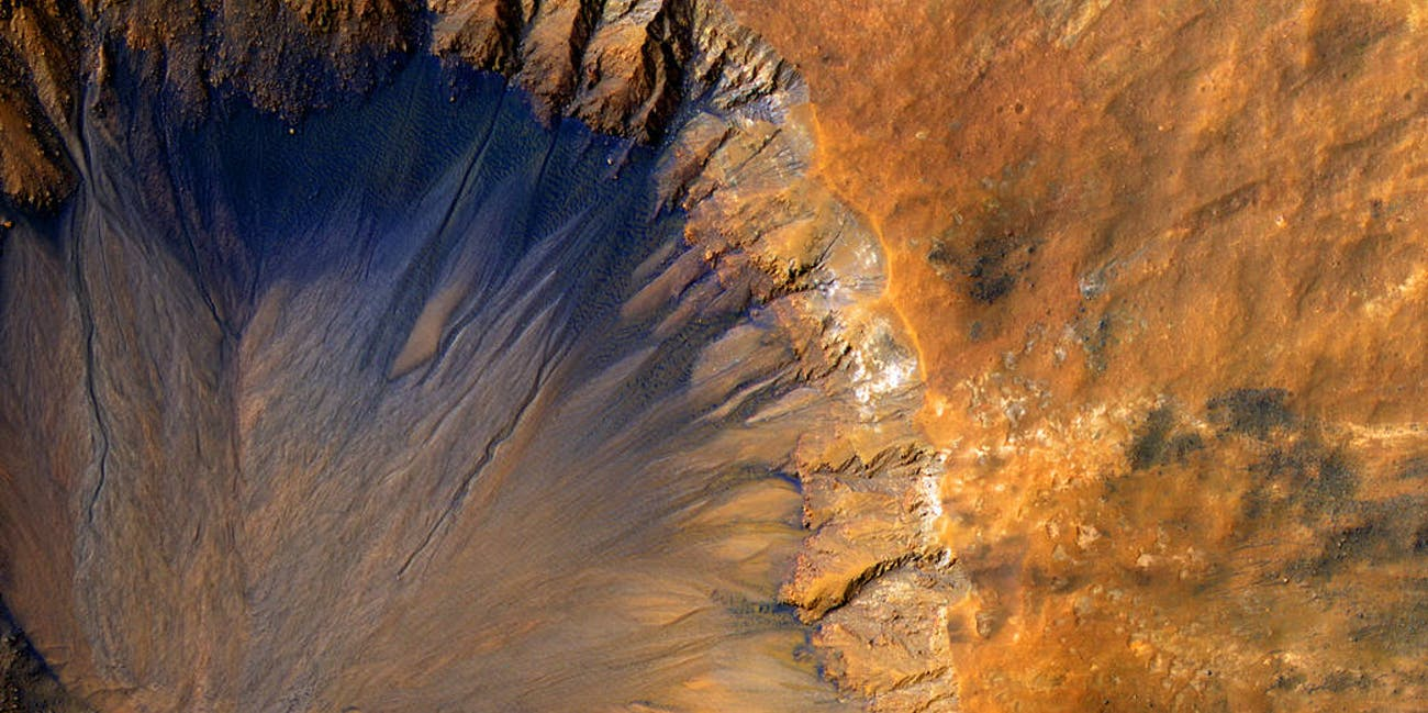 A fresh crater near the Sirenum Fossae Region of Mars.