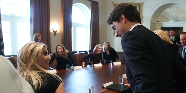 Canadian Prime Minister Justin Trudeau (R) helps Ivanka Trump with he chair during a roundtable discussion on the advancement of women entrepreneurs and business leaders at the White House February 13, 2017 in Washington, DC. Later in the day Prime Minister Justin Trudeau will joing U.S. President Donald Trump in a joint news conference.