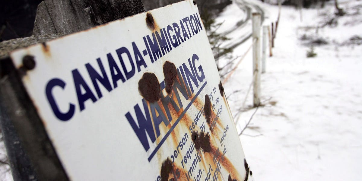 A sign sign marks the border between Canada and the U.S. March 22, 2006 near Beecher Falls, Vermont. As American politicians continue to debate immigration reform Border Patrol agents work the northern border to prevent illegal entry.