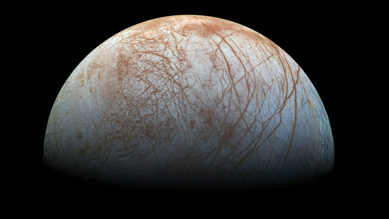 The surface of Europa is covered in ice, and there's strong evidence of liquid water underneath.