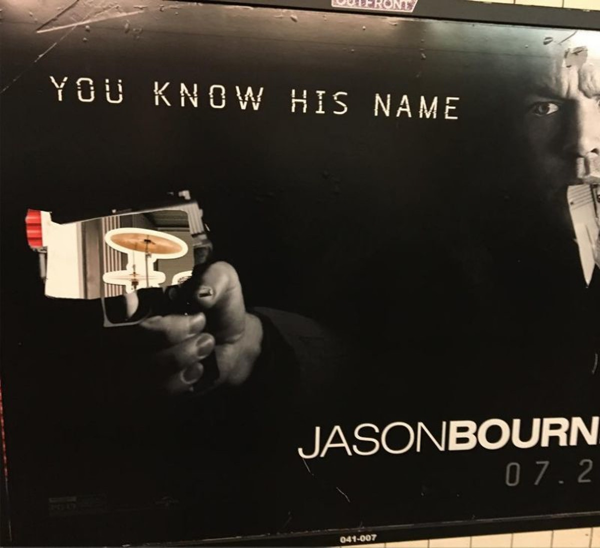 A defaced Bourne poster on the NYC subway