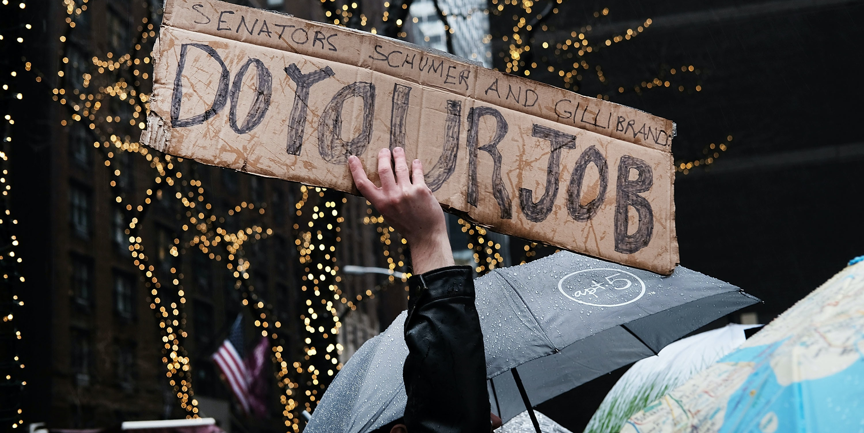 NEW YORK, NY - JANUARY 24:  Over 100 protesters hold a rally in heavy rain outside of the offices of Democratic Senators Chuck Schumer and Kirsten Gillibrand to demand that they hold up the nomination process of President Donald Trump's cabinet choices on January 24, 2017 in New York City.