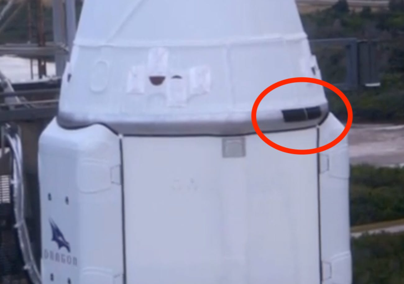 This zoomed-in photograph of the Dragon cargo capsule atop the Falcon 9 rocket on Thursday shows the panels that were being tested for the SpaceX Starship.