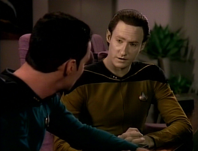 Data explains he's a person and a robot.