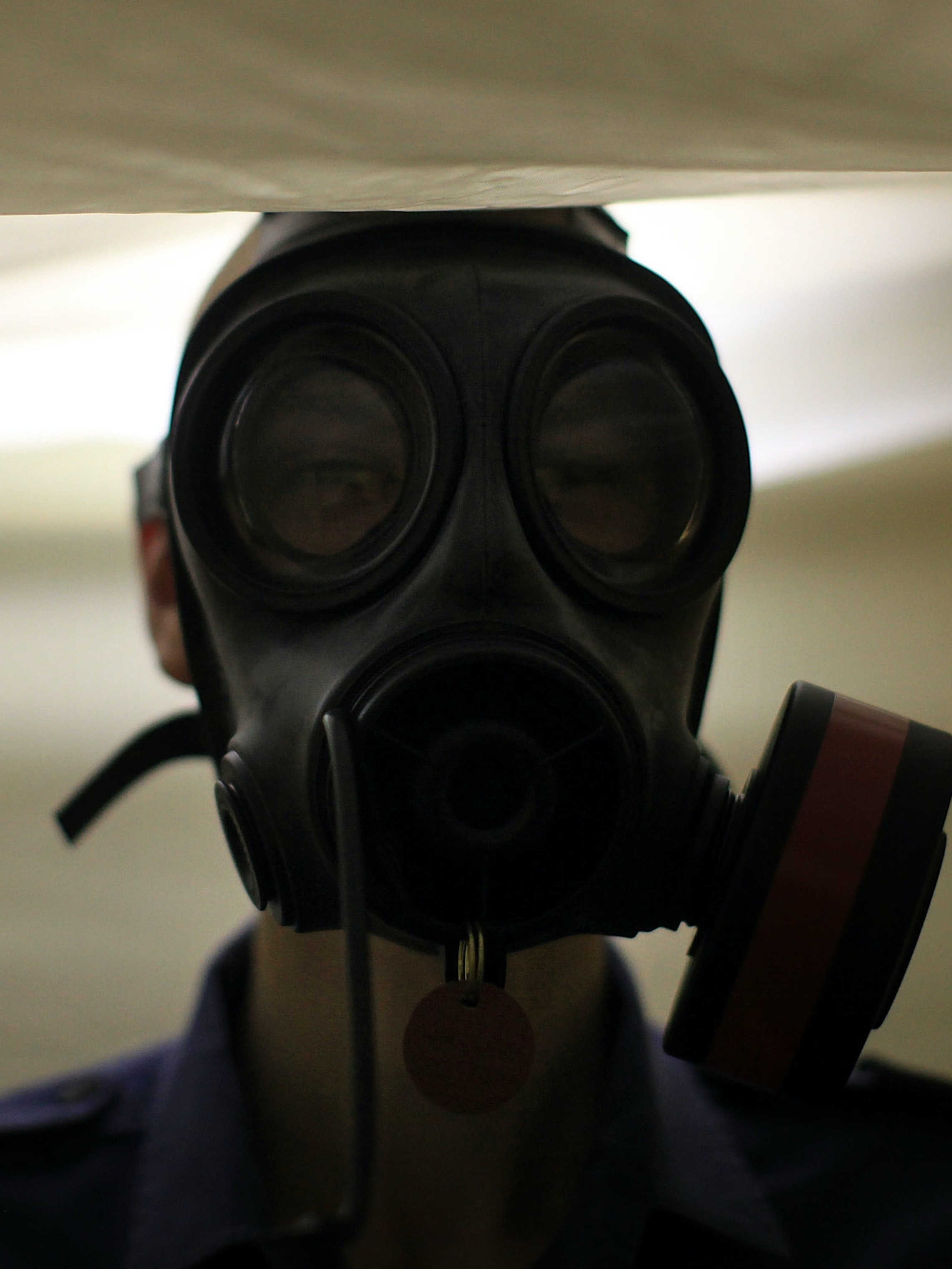 AT SEA - JULY 14:  A sailor has his gas mask tested in a sealed tent below deck on HMS Ark Royal during Exercise Auriga on July 14, 2010 at sea in Onslow Bay near North Carolina. HMS Ark Royal, the nation's strike carrier, is leading an international task group during exercise Auriga 2010 a joint US-British amphibious exercise in Onslow Bay, off the cost of North Carolina. Auriga 2010 will demonstrate the UK's ability to deploy, operate and sustain a task group out of area for a prolonged period. At full strength the Ark Royal has a full crew of 1100 to 1200. At 210 metres in length and weighing 20,000 tonnes she is the fifth vessel in the history of Britain's Royal Navy to carry the historic name of Ark Royal and is currently celebrating 25 years at sea.  (Photo by Christopher Furlong/Getty Images)