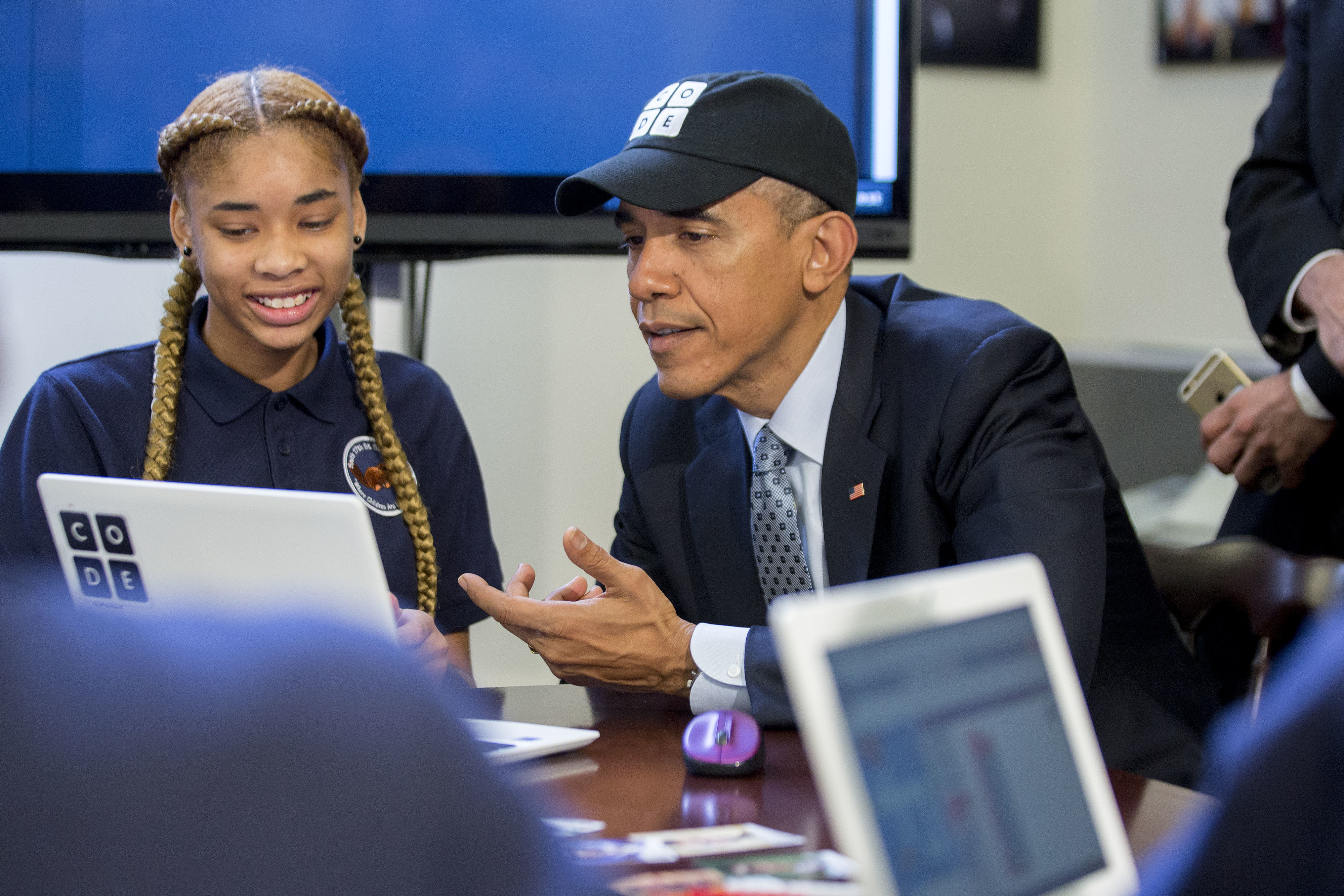 Obama looking at a computer, a crucial tool in the digital media world.