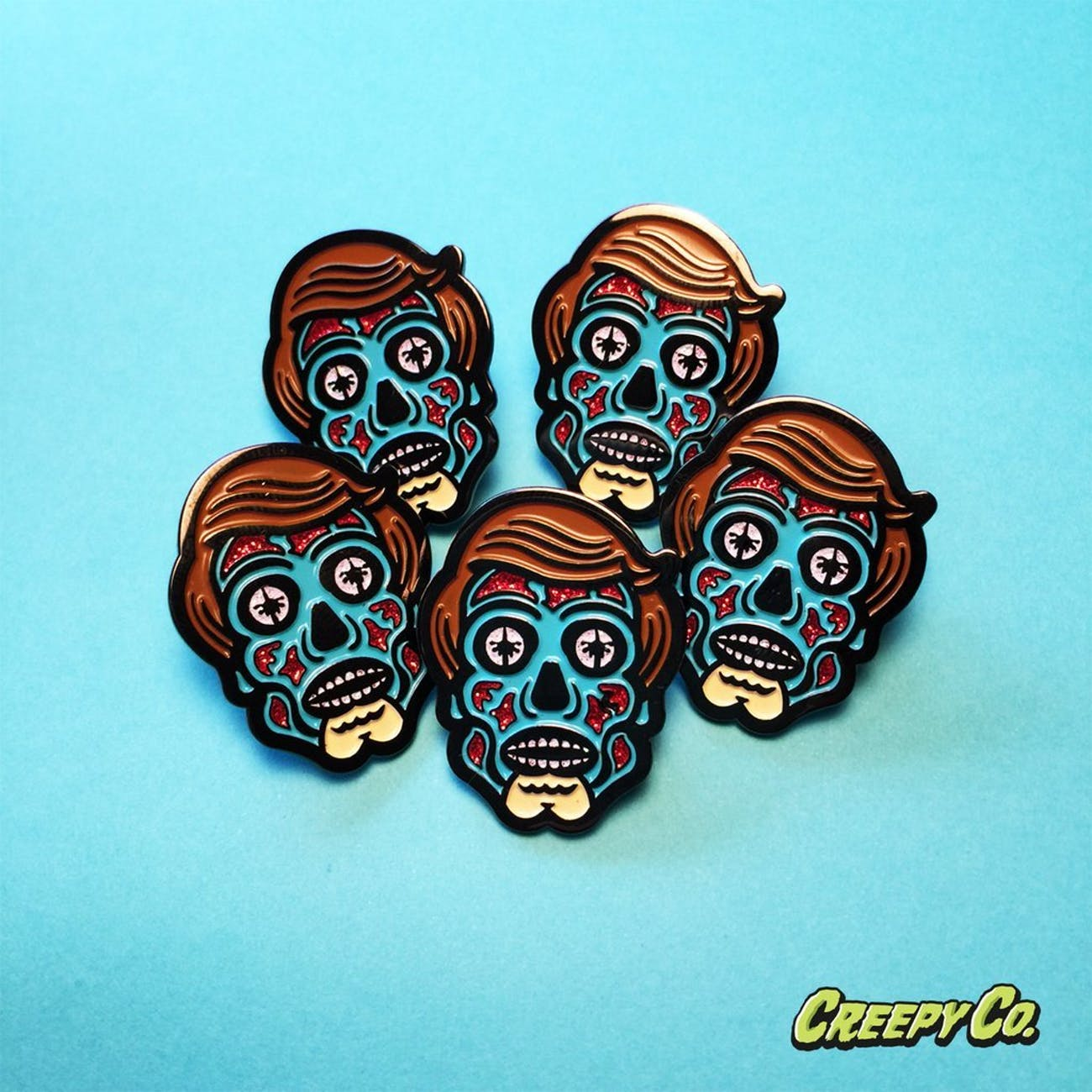 "Creepy Co.'s 'All Consuming Alien"" pin design based on John Carpenter's 'They Live.'"