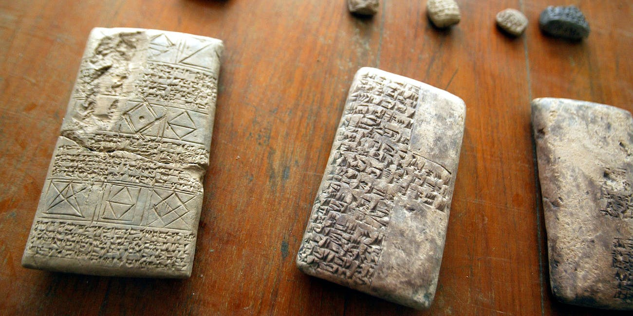 BAGHDAD, IRAQ - APRIL 29: Tablets and other stolen antiquities that were returned in recent days to the Iraqi National Museum are displayed at the museum April 29, 2003 in Baghdad, Iraq. The museum was severely looted during the war but some missing items are being recovered by coalition forces. (Photo by Mario Tama/Getty Images)