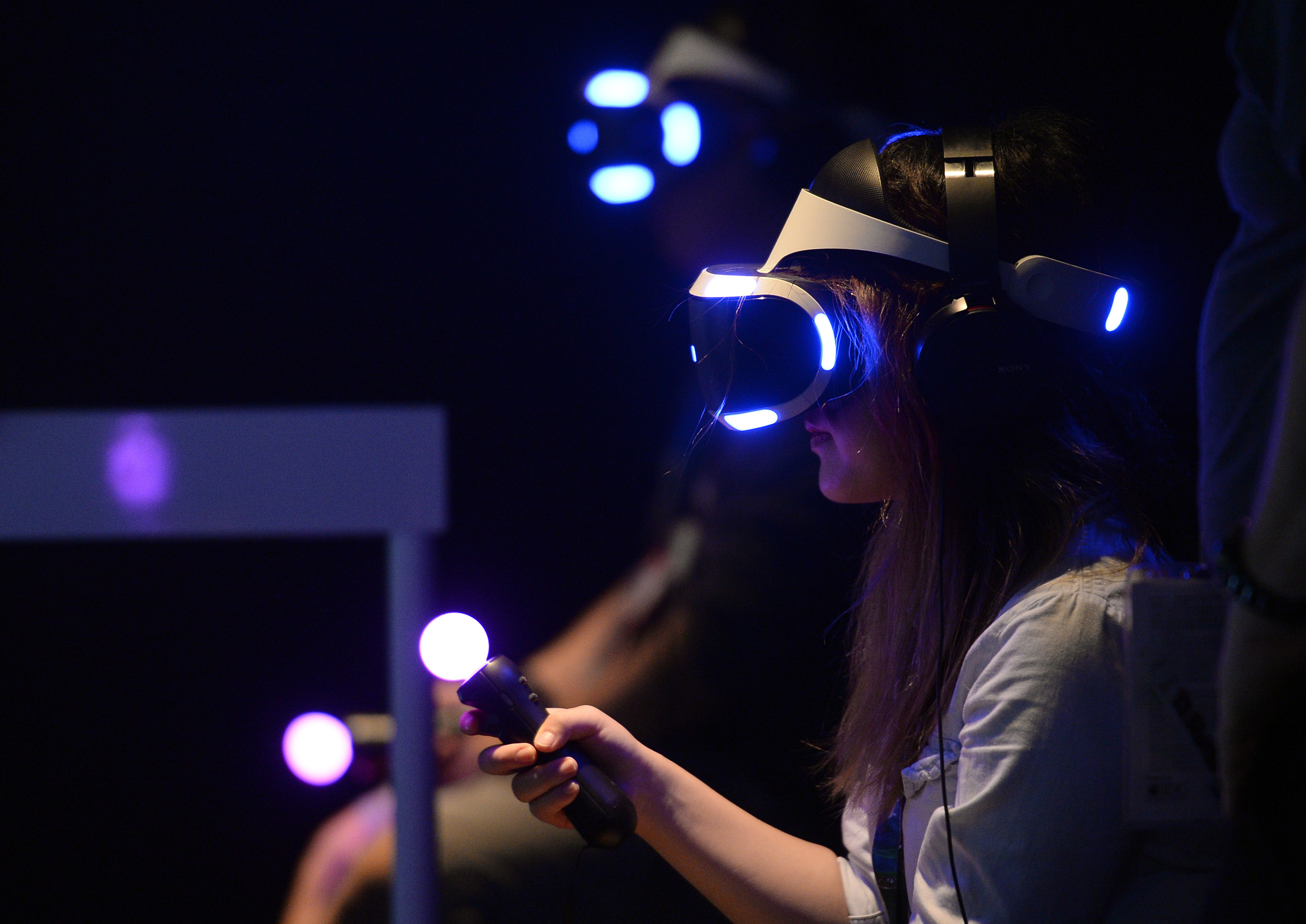 LOS ANGELES, CA - JUNE 14: Gamers try out the new Sony VR headset in Sony Playstation booth during the annual E3 2016 gaming conference at the Los Angeles Convention Center on June 14, 2016 in Los Angeles, California. The Electronic Entertainment Expo will run from June 14 -16. (Photo by Kevork Djansezian/Getty Images)