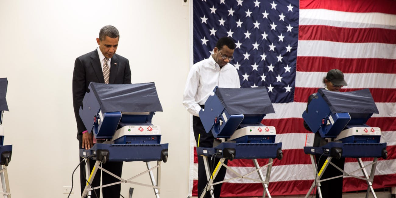 Barack Obama votes in 2012.