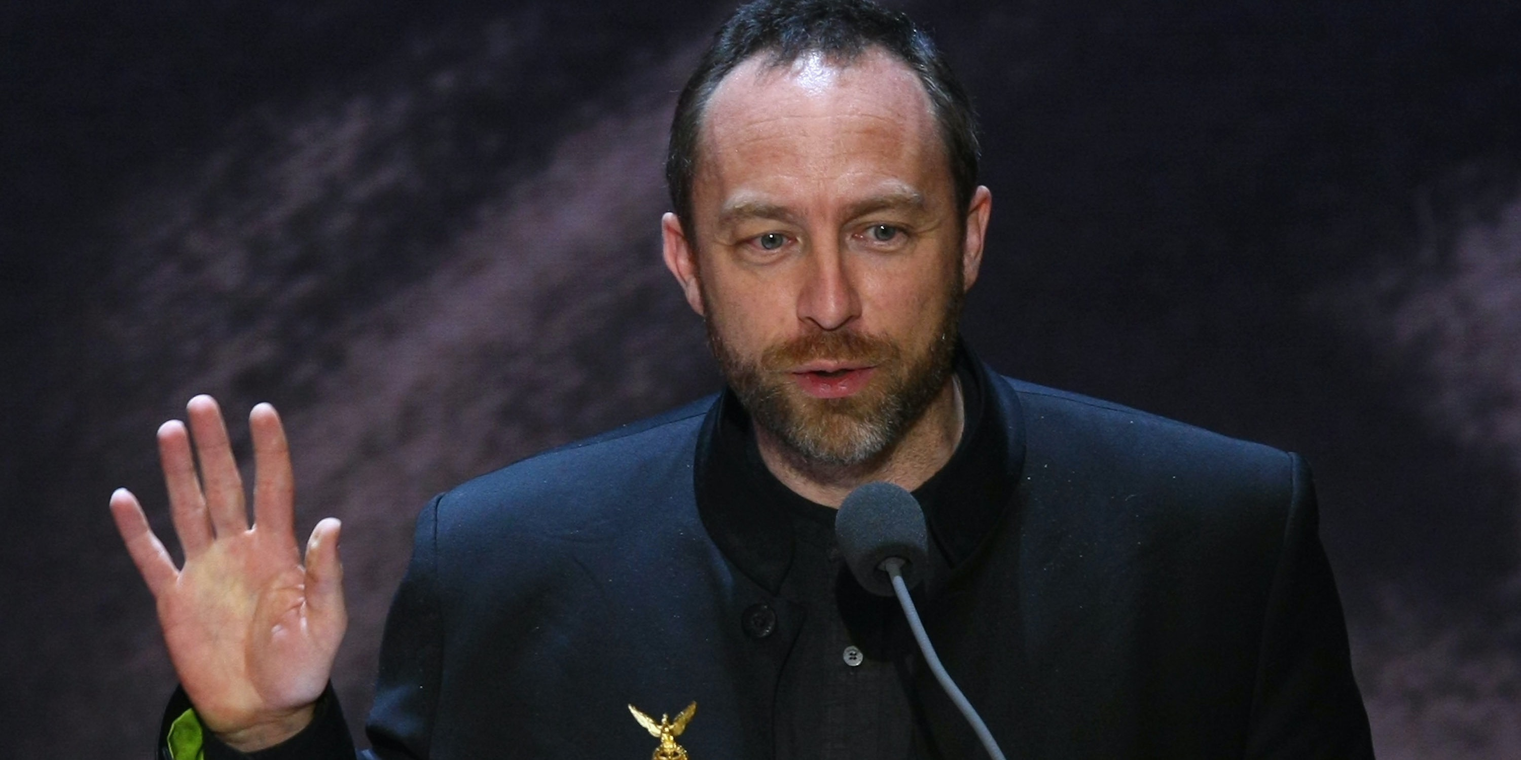 Wikipedia founder Jimmy Wales speaks after receiving a Quadriga Award for innovation in Berlin, Germany.