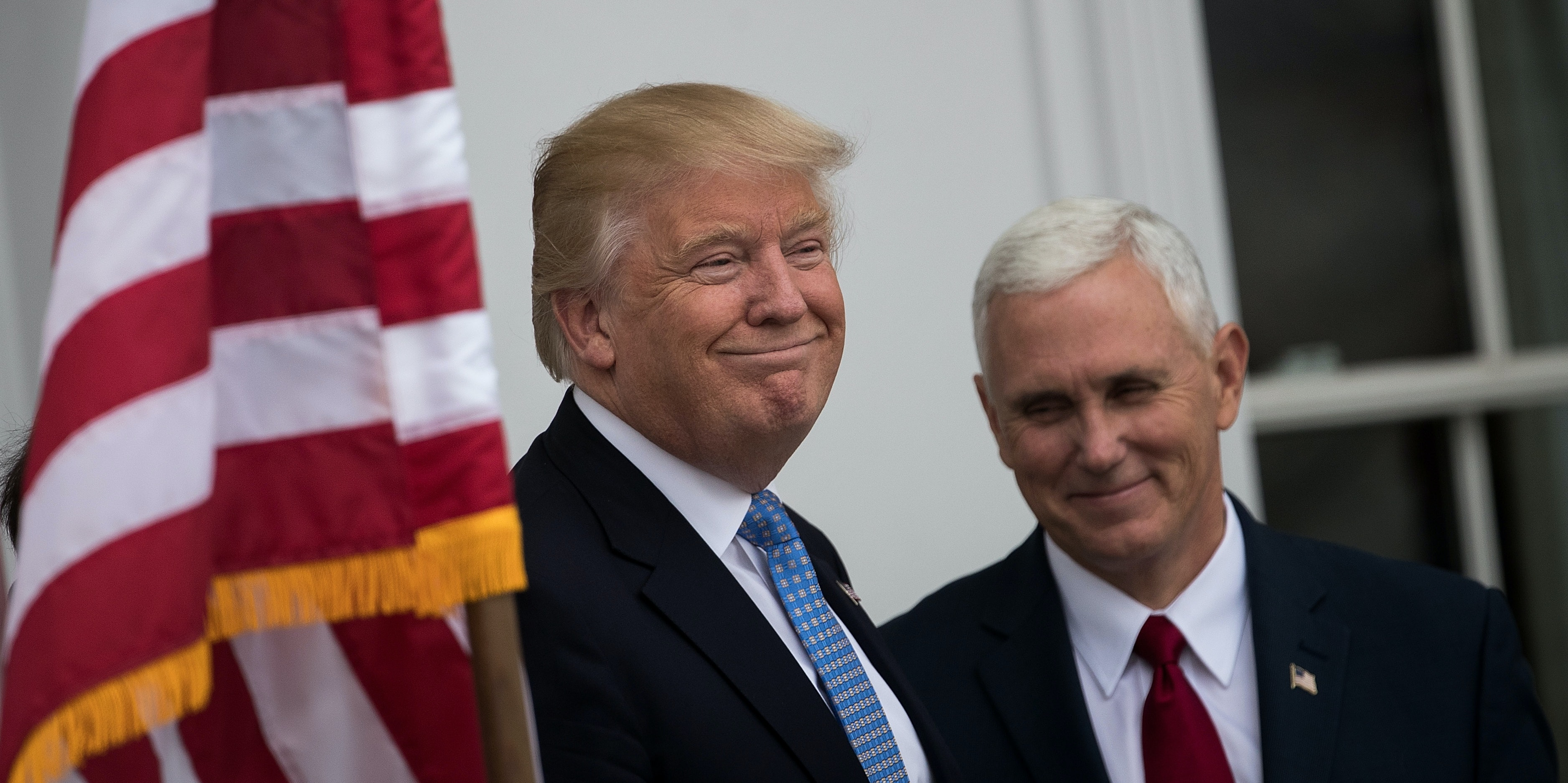 BEDMINSTER TOWNSHIP, NJ - NOVEMBER 20: (L to R) President-elect Donald Trump and vice president-elect Mike Pence listen to a question from the press regarding the musical 'Hamilton' before their meeting with investor Wilbur Ross at Trump International Golf Club, November 20, 2016 in Bedminster Township, New Jersey. Pence was booed when he attended the Broadway musical and a cast member read him a message after the show. Trump and his transition team are in the process of filling cabinet and other high level positions for the new administration.  (Photo by Drew Angerer/Getty Images)