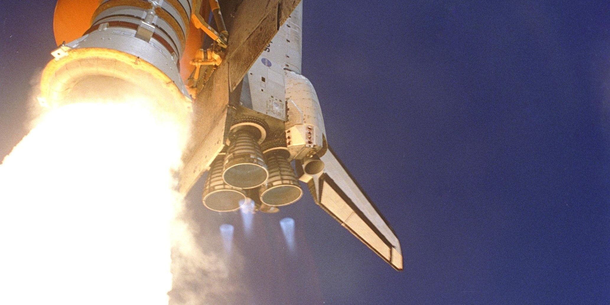 In this handout photo provided by NASA, Space Shuttle Discovery kicks off the Fourth of July fireworks with its own fiery display as it rockets into the blue sky, spewing foam and smoke over the ground, on mission STS-121 July 4, 2006 at the Kennedy Space Center in Cape Canaveral, Florida. It was the third launch attempt in four days; the others were scrubbed due to weather concerns. Liftoff was on-time at 2:38 p.m. EDT. During the 12-day mission, the STS-121 crew of seven will test new equipment and procedures to improve shuttle safety, as well as deliver supplies and make repairs to the International Space Station. Landing is scheduled for July 17 at Kennedy's Shuttle Landing Facility.