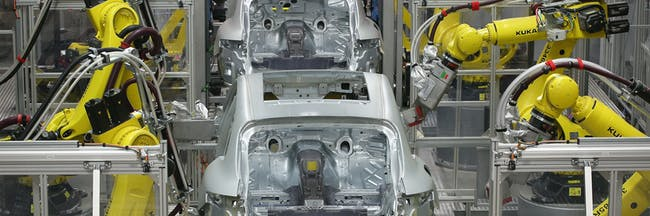 LEIPZIG, GERMANY - FEBRUARY 11:  Robots weld the bodies of Porsche Macan SUVs at the new Porsche Macan factory at the Porsche plant on February 11, 2014 in Leipzig, Germany. Porsche plans to produce 50,000 of the new small SUV Macan annually.  (Photo by Sean Gallup/Getty Images)