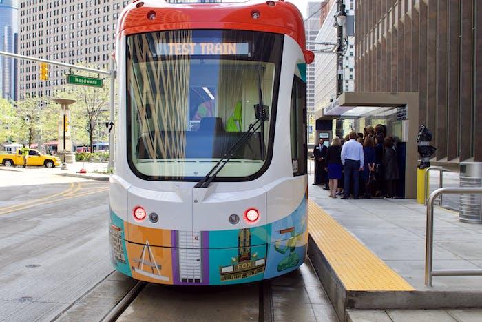 Detroit Q Line streetcar test car commuters