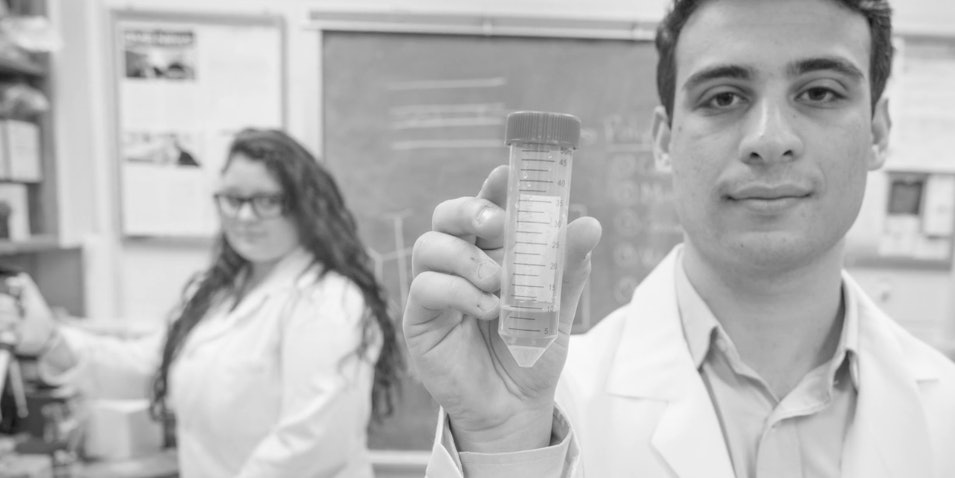 Kevin Eisenfrats holding a polymer that can stop sperm.