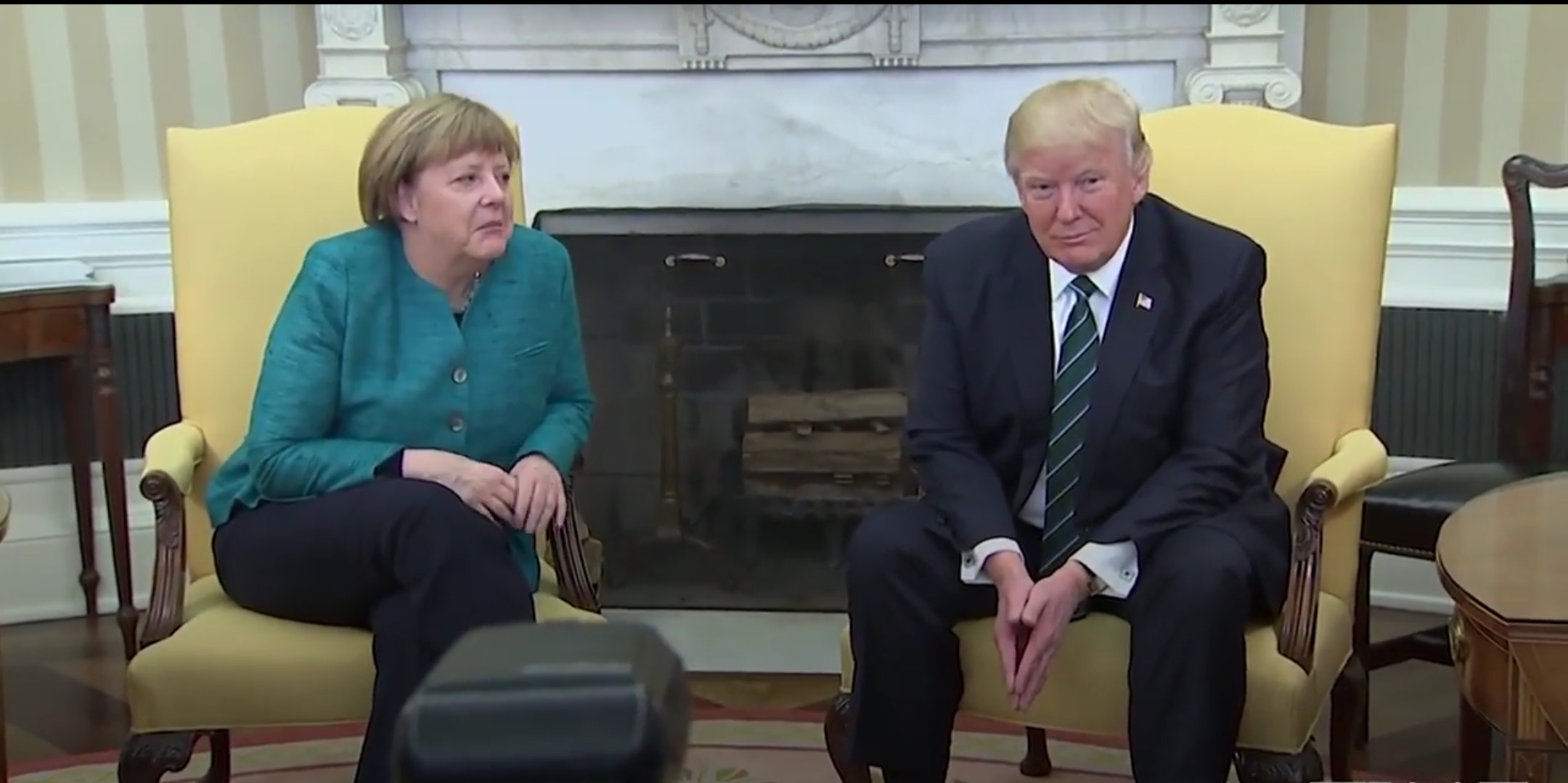 Donald Trump's refusal to shake Angela Merkel's hand serves as a reminder of the tensions between the two leaders.