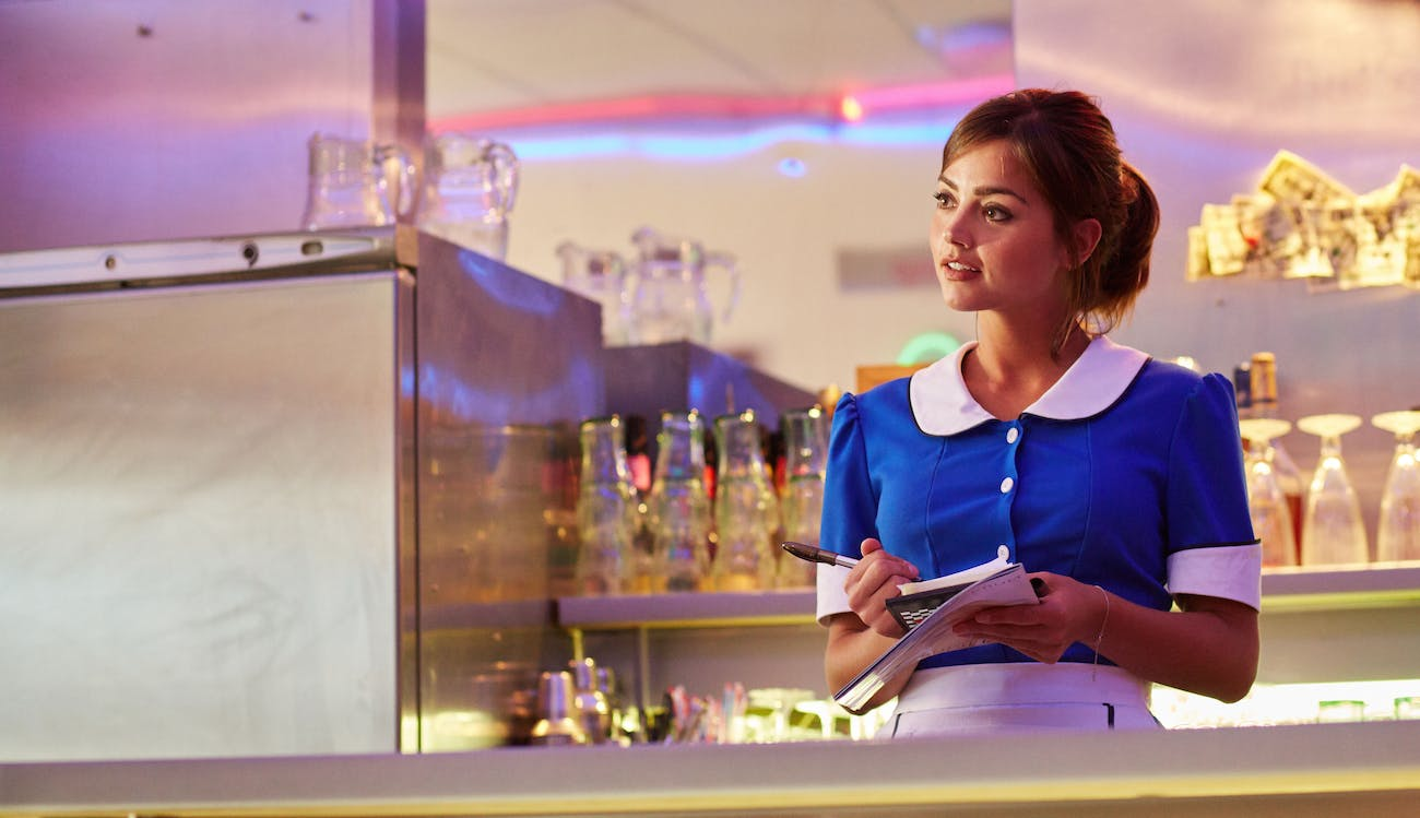 Clara in the diner portion of her TARDIS.