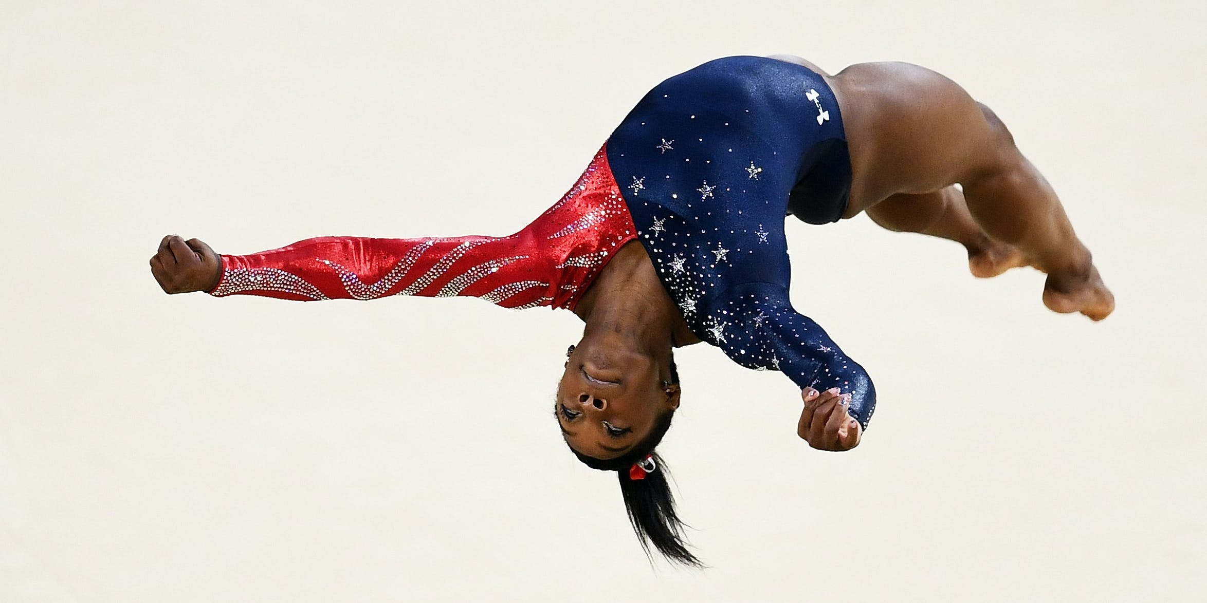 RIO DE JANEIRO, BRAZIL - AUGUST 07:  Simone Biles of the United States competes on the floor during Women's qualification for Artistic Gymnastics on Day 2 of the Rio 2016 Olympic Games at the Rio Olympic Arena on August 7, 2016 in Rio de Janeiro, Brazil  (Photo by David Ramos/Getty Images)