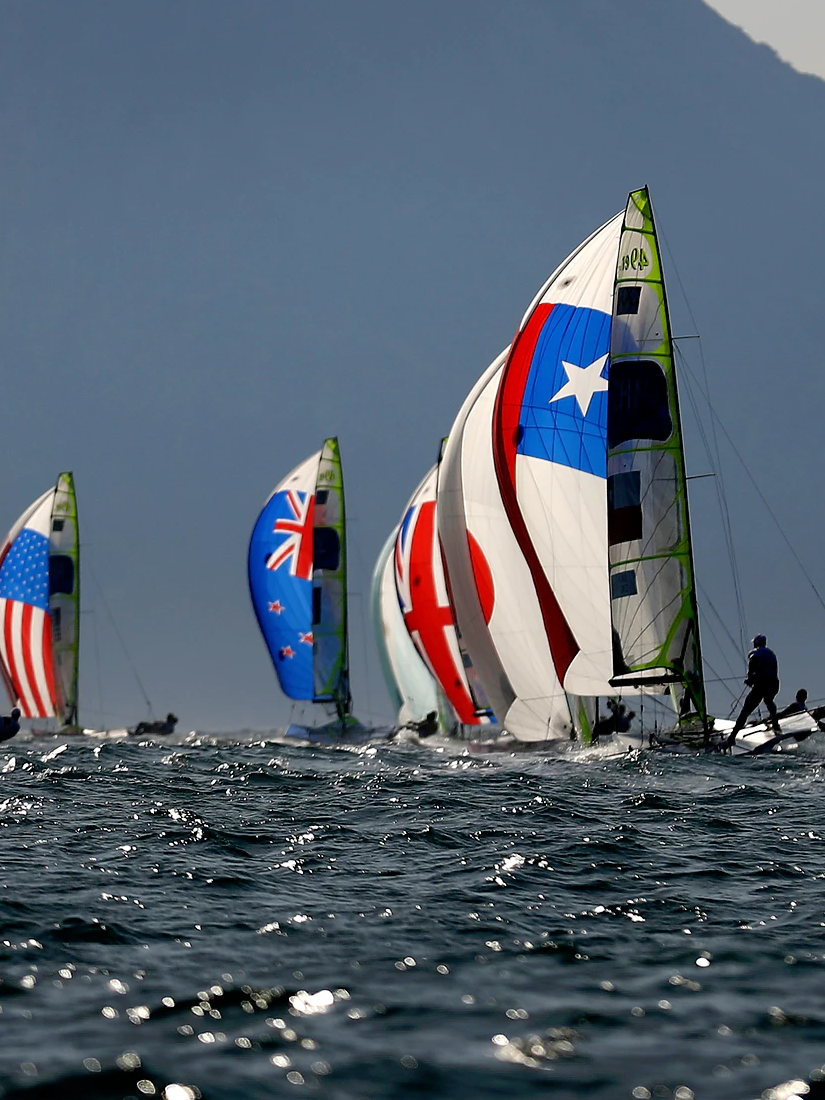 RIO DE JANEIRO, BRAZIL - AUGUST 15:  The mens 49er fleet head downwind towards Sugarloaf Mountain on Day 10 of the Rio 2016 Olympic Games at the Marina da Gloria on August 15, 2016 in Rio de Janeiro, Brazil.  (Photo by Clive Mason/Getty Images)