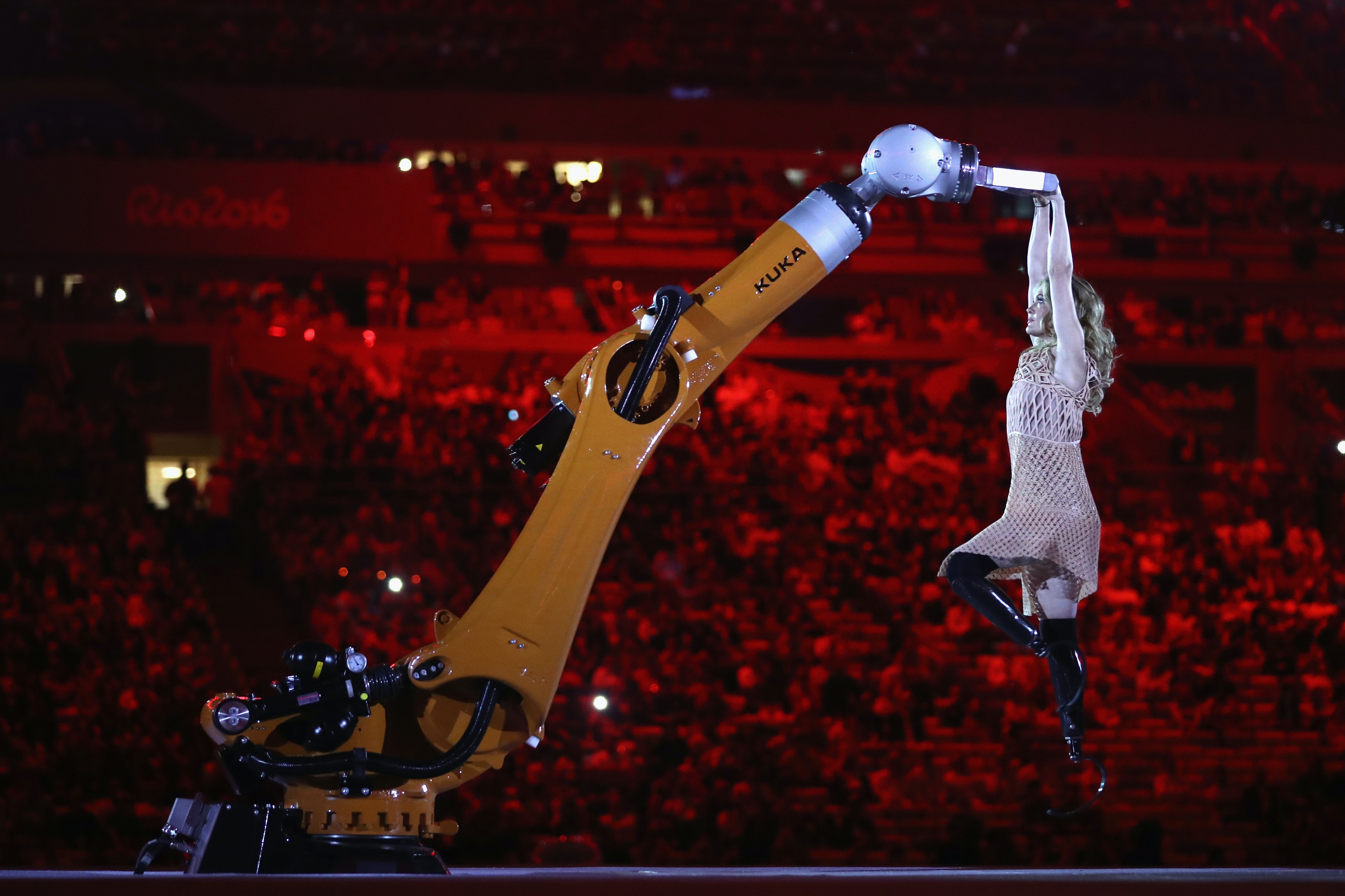 Dancer Amy performs with robot KUKA during the Opening Ceremony of the Rio 2016 Paralympic Games.