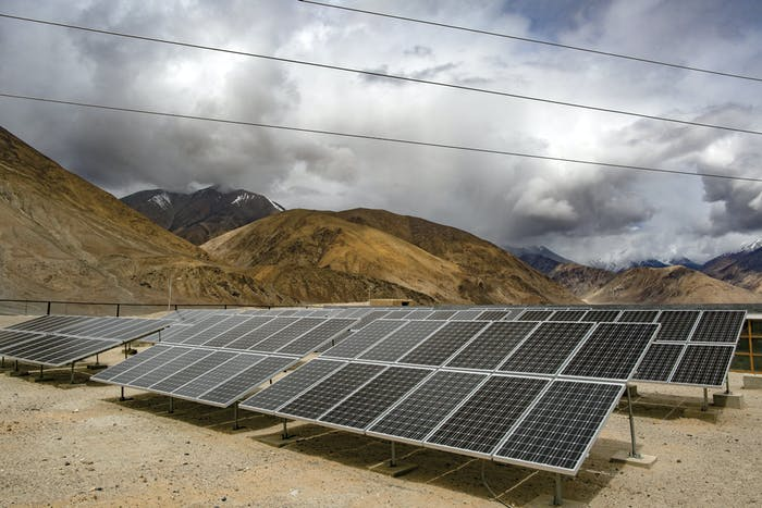 LADAKH, INDIA - JUNE 14: Solar panels are seen in Yarat village on June 14, 2017 in Ladakh, India. The cold desert of Ladakh has been known as the roof of the world and reportedly a region with huge potential in tapping the solar energy with its vast patches of barren land surrounded by mountains. As U.S. President Donald Trump announced plans to withdraw from the Paris agreement on climate change, Indian Prime Minister Narendra Modi said two days later that India was 'part of the world's shared heritage' and that the country would 'continue working... above and beyond the Paris accord'. At the Leh district, located at the altitude of 11,562 feet, the Ladakh Renewable Energy Development Agency is currently working on renewable energy, including solar, projects throughout Ladakh despite challenges at the mountainous terrain and sees the opportunity to earn revenue by exporting electricity to demand centers in North India while its residence simply hope to attain energy independence. Based on reports, China and India will be the biggest recipients for renewables energy with the highest power-generating capacity by 2040. India had planned to build the world's largest solar power project in Ladakh back in 2014 but the project was later announced this year to be placed it on hold due to the huge costs on the transmission system while the country continues by focusing on smaller projects instead. (Photo by Allison Joyce/Getty Images)