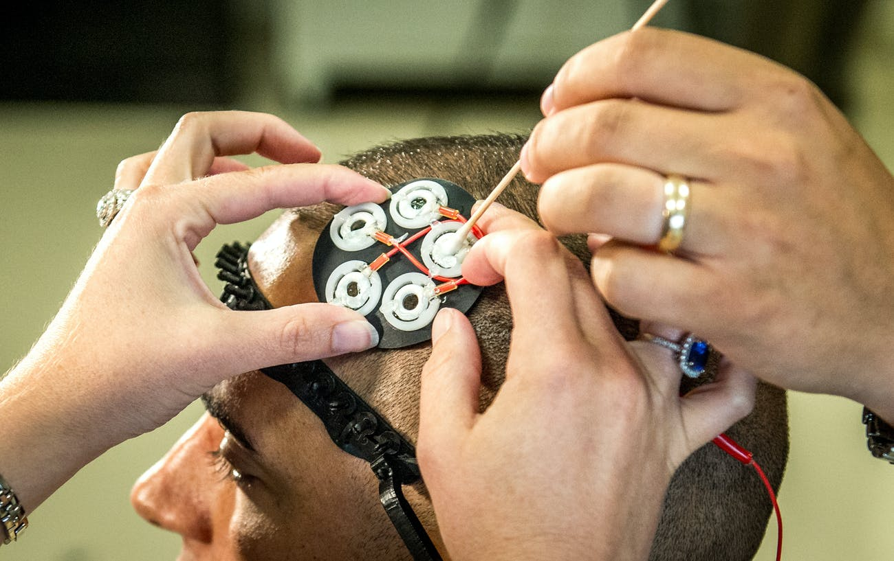 Electrodes to administer directed electrical brain stimulation are placed on the head of a test subject before he performs a multitasking cognitive test in the Non-Invasive Brain Stimulation (NIBS) lab at the Air Force Research Laboratory, Wright Patterson Air Force Base, Ohio, Jul 19, 2016. Researchers working in the NIBS lab, led by Dr. Richard A. McKinley, Ph.D., are exploring how transcranial direct current stimulation of the human brain affects cognition, fatigue, mood and other areas with the end goal of improving warfighter awareness, memory and focus. (U.S. Air Force photo by J.M. Eddins Jr.)